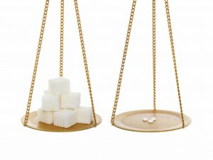 Sugar vs small healthy sugar sweeteners. On balance. Isolated over white