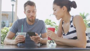 image source: http://www.shutterstock.com/video/clip-8992519-stock-footage-cafe-couple-looking-at-smart-phone-screen-app-laughing-having-fun-on-date-drinking-coffee-in-summer.html