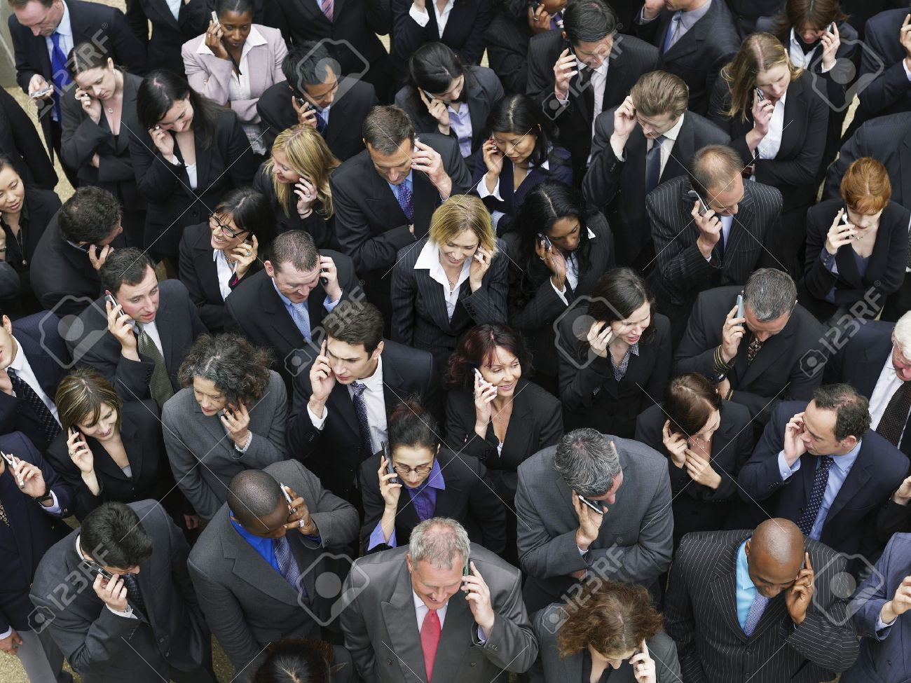 Large group of business people using mobile phones elevated view Stock Photo