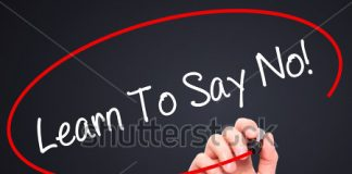 stock photo man hand writing learn to say no with black marker on visual screen isolated on background