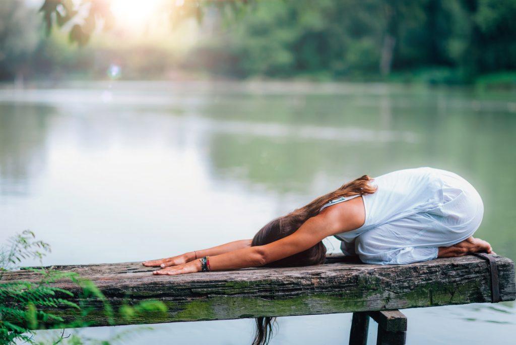 Yoga Woman by The Lake. Balasana