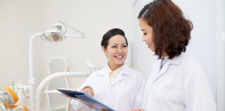 Dentist talking to nurse