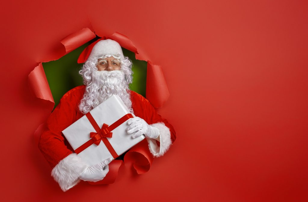 Santa Claus on color background.