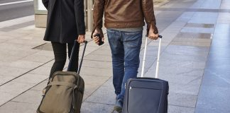 Young couple with baggage on the street. Travel and tourism