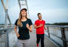 Healthy sporty young people jogging and running outdoors