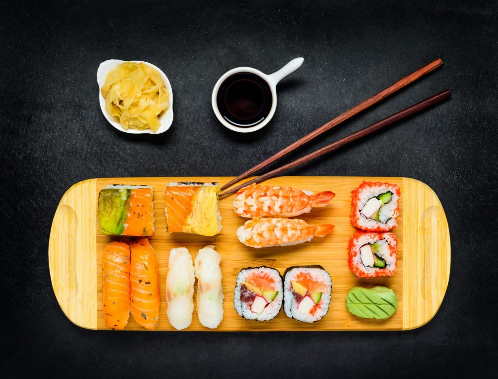 Japanese Cuisine Food with Sushi, Soy Sauce and Tsukemono
