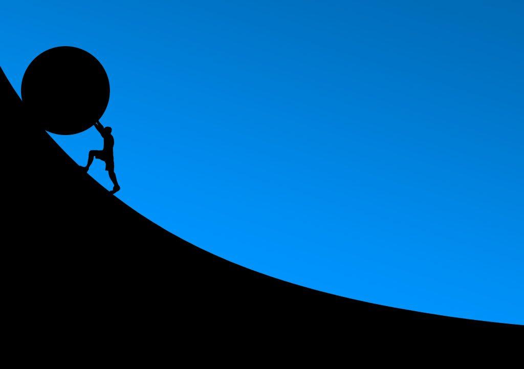 Pushing stone uphill.