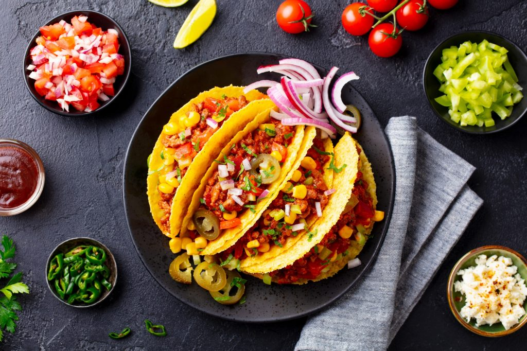 Taco with Beef. Mexican Traditional Cuisine. Dark Background. Top View.