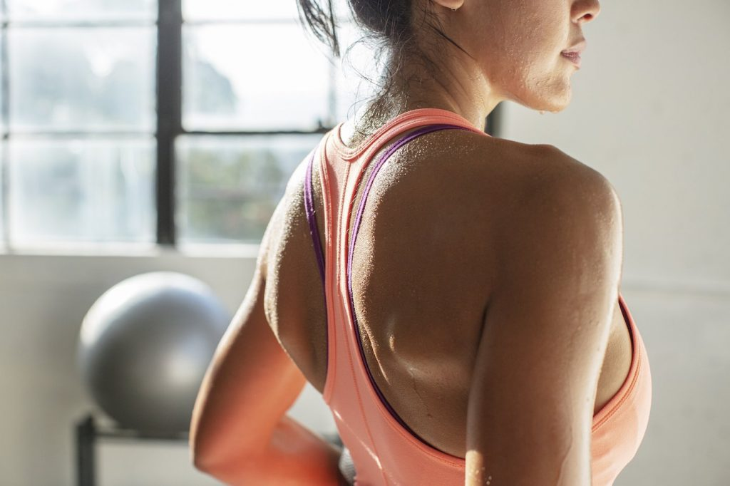 sweaty exercise, dripping down skin woman