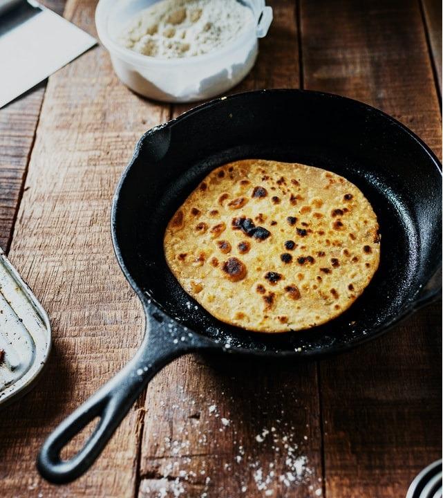 Egg-cooked roti on Tawa