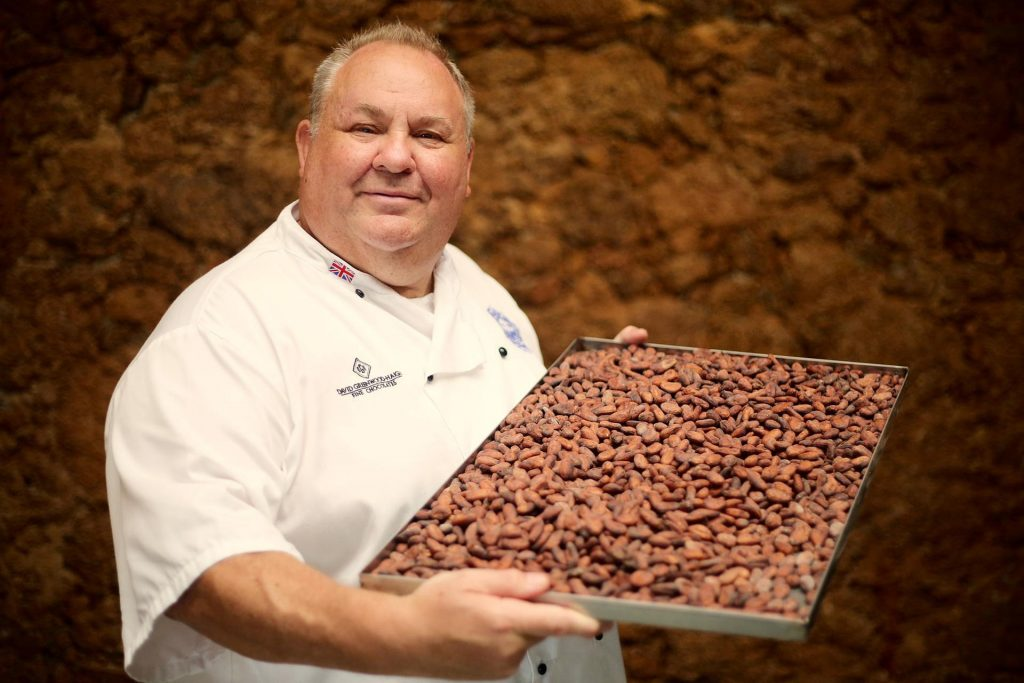 Chocolatier holding almonds
