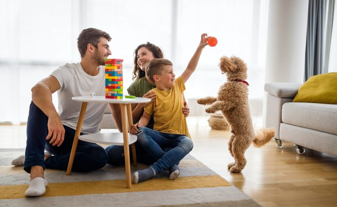 Happy family having fun, playing board game at home