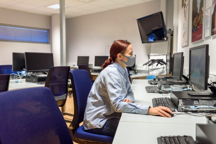 Woman student in computer class