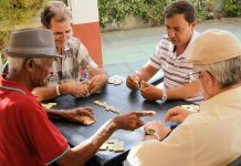Active Retirement Happy Old Friends Playing Domino Game