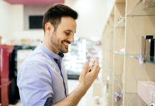 Handsome man buying fragrances