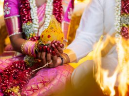 Indian Hindu Traditional Wedding Ceremony - Close up shot of the couple hand holding the decorative