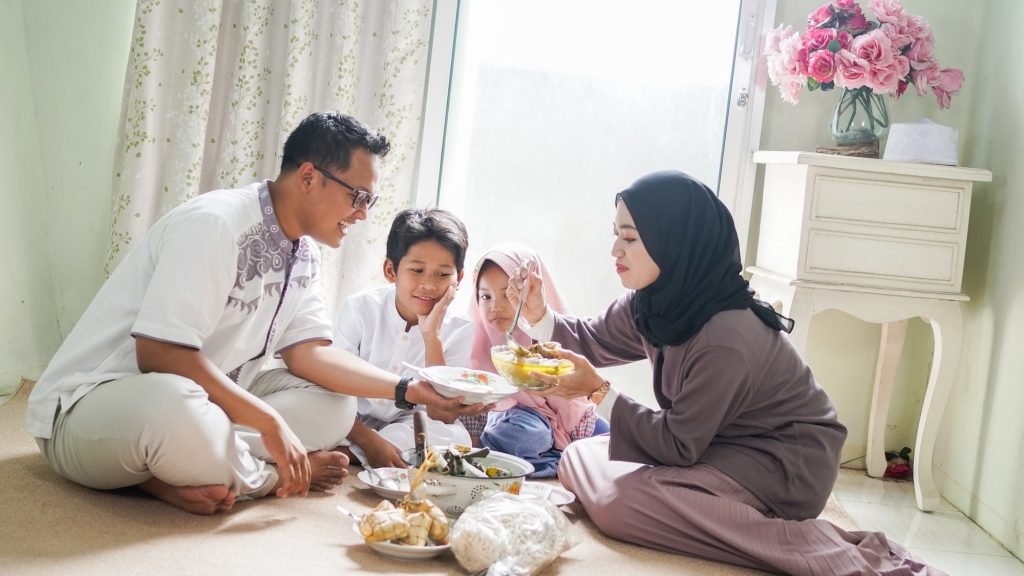 The family tradition of Eid al-Fitr is to eat ketupat opor or side dishes