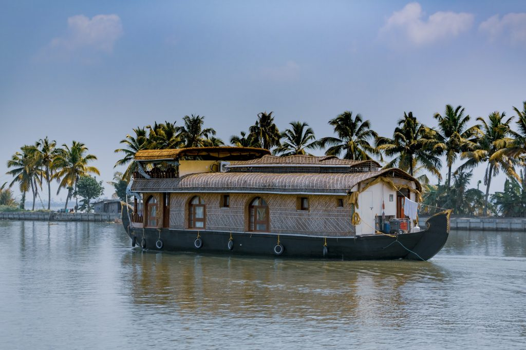 House boat sailing through Kerala backwaters